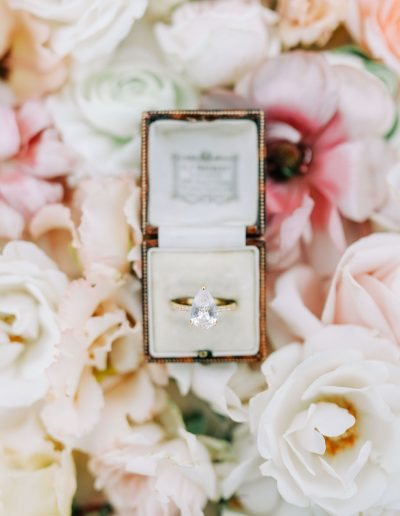 Wedding ring in box flatlay with flowers by flourish and grace