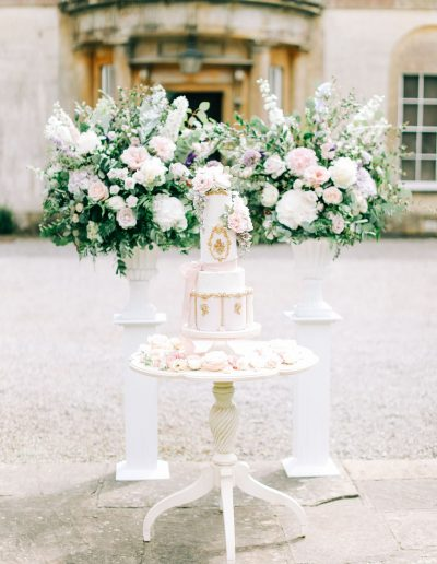Pastel pink blue lilac wedding urns and cake with flowers by flourish and grace