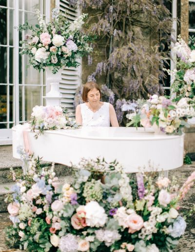 Pastel pink blue lilac wedding urns and piano with flowers by flourish and grace