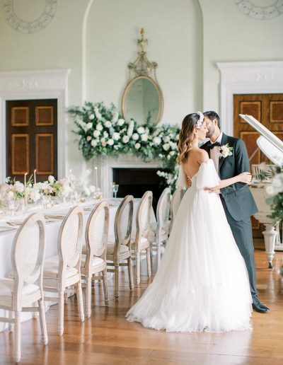 Bride and groom surrounded by fireplace flowers and mantlepiece flowers by Flourish and Grace