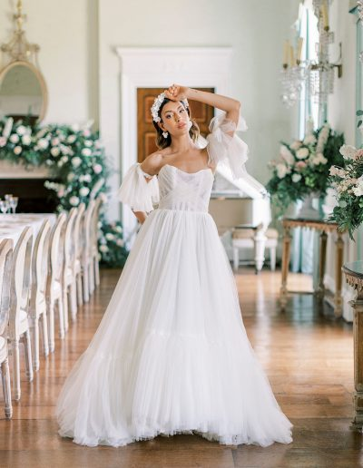 Bride surrounded by fireplace flowers and mantlepiece flowers by Flourish and Grace