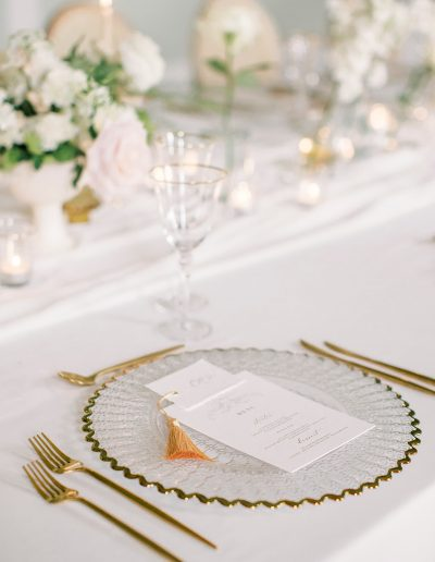 Wedding table flowers with plate and stationery by flourish and grace