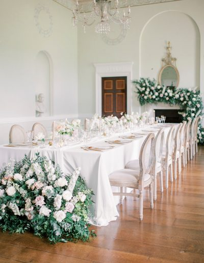 Wedding Fireplace and table flowers by flourish and grace