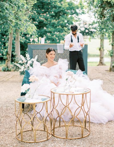Bride and groom with bar and urn flowers by flourish and grace