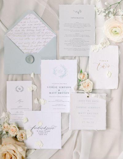 Fine art Wedding Stationery flat lay with flowers by Flourish and Grace, Bristol Wedding Florist