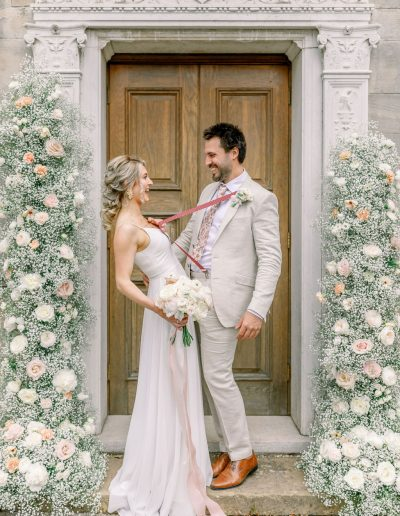 Bride and groom bouquet and flower arch by Flourish and Grace, Bristol Wedding Florist