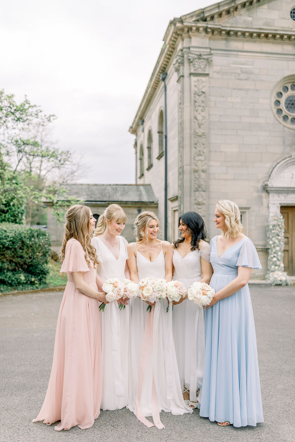 Bridesmaids in TH&H dresses and bride in wedding dress with bouquets by Flourish and Grace, Bristol Wedding Florist