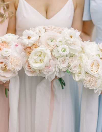 Bridesmaids in TH&H dresses and bride in wedding dress with bouquets and silk ribbon by Flourish and Grace, Bristol Wedding Florist