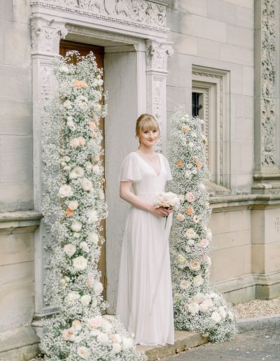 Fine art Bride in TH&H wedding dress with bouquet and flower arch by Flourish and Grace, Bristol Wedding Florist and featured on Love My Dress Wedding Blog