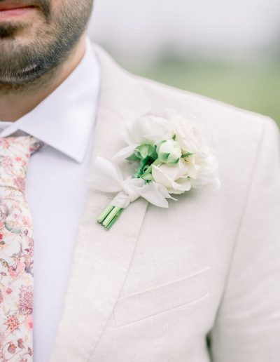 Groom with buttonhole boutonniere and silk ribbon by Flourish and Grace, Bristol Wedding Florist