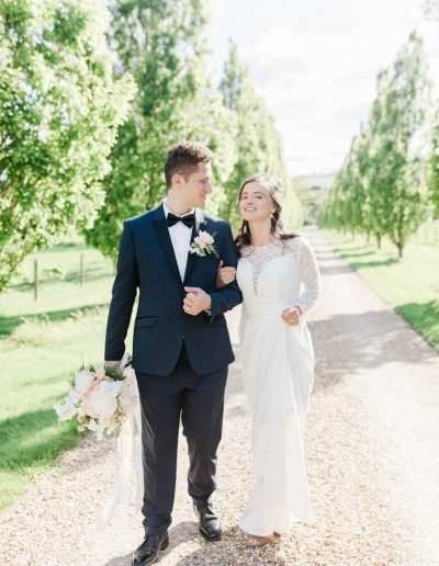Fine art Bride and groom with wedding bouquet and silk ribbons by Flourish and Grace