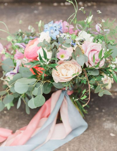 Flourish and Grace wedding bouquet flowers with roses ranunculus and eucalyptus
