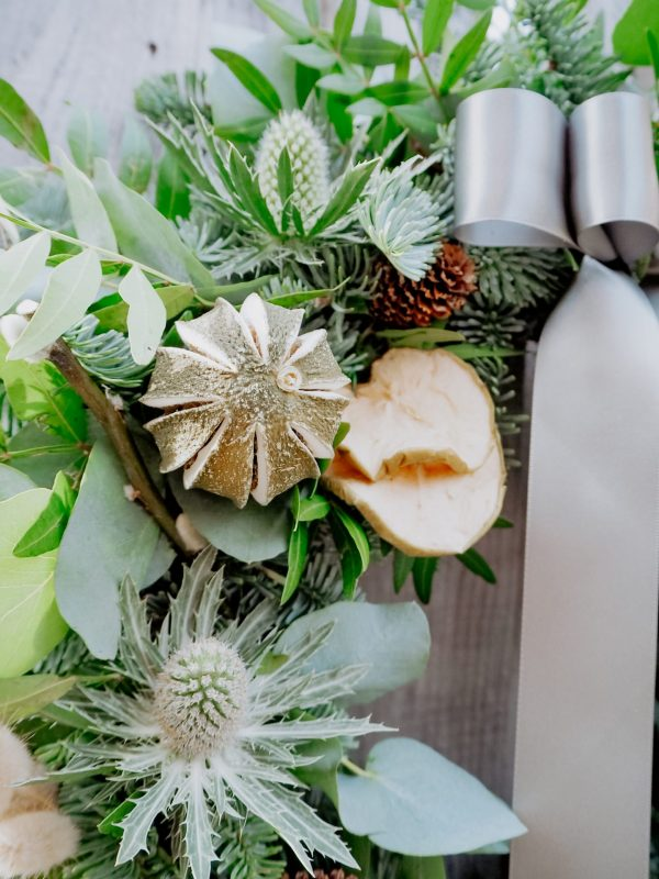 Christmas wreath with festive decorations fruit slices pinecones and ribbon for delivery Bristol postage across the uk