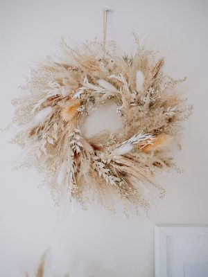 Pampas dried wreath by Flourish and Grace on a white wall