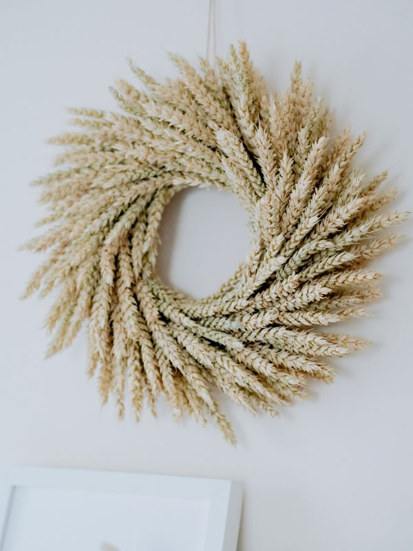 Wheat dried wreath by Flourish and Grace on a white wall