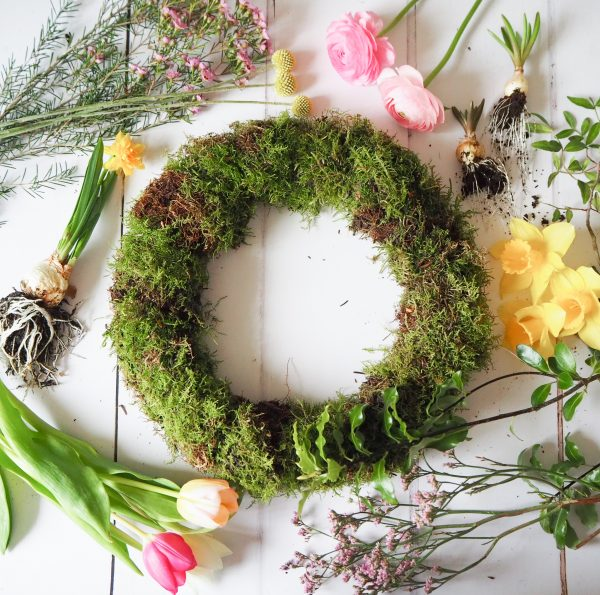 Flourish and Grace Spring wreath kit flatlay with mossed wreath and flowers