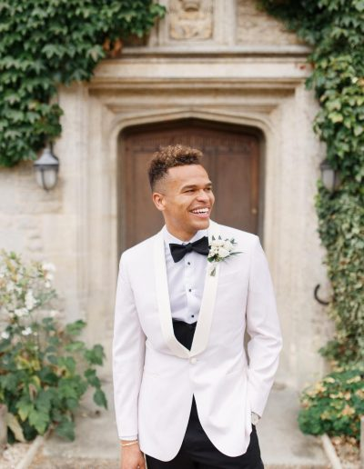 Cotswolds wedding at Hyde House Barn with flowers by Flourish and Grace and photography by White Stag Weddings black tie groom tux